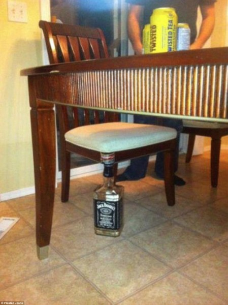 Oops! The chair broke a leg. Well a scotch bottle and a few pieces of plastic will fix that.