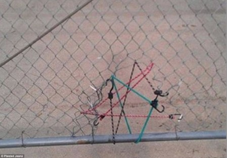 Hole in the fence? Bungee cords will fix that.