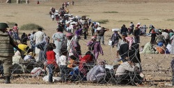 Kobani Citizens Flee The Terror By Crossing Into Turkey