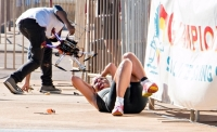 Triathlete Raija Ogdenman Lays Injured As The Pieces Of The Drone That Hit Her Are Recovered.