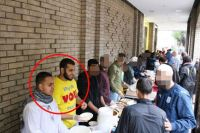 Before They Fled: Jihadists Reyaad Khan and Nasser Muthana (circled) Hand Out Food To The Needy In Cardiff Last Year.