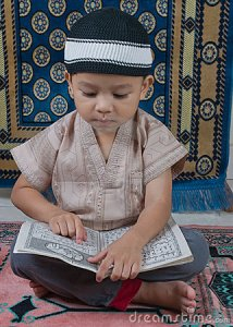 Small Child Learning The Qu'ran