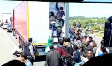Illegals Attempting To Enter A Truck.
