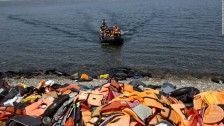 Discarded Life-vests And Dingies On The Shores Of Lesbos