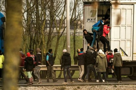 Dec. 17 - Migrants force their way into a truck.