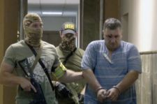 Yevhen Panov Shown In Custody